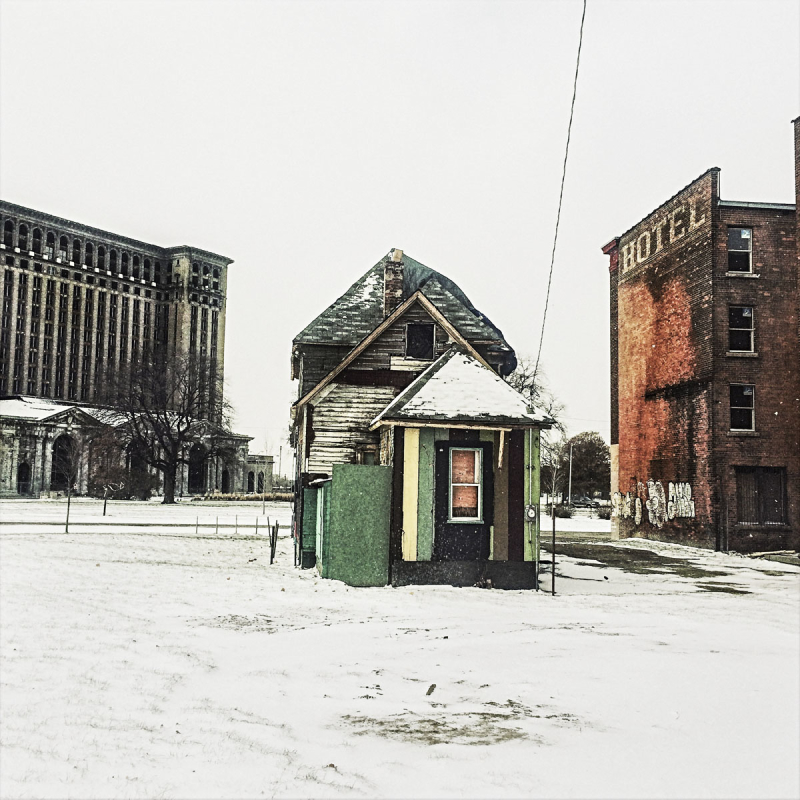 A boarded-up house next to the former Michigan Central Station building near downtown Detroit. Photo: Balazs Gardi