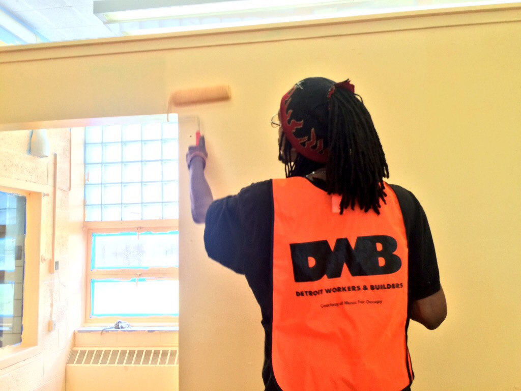 A formerly homeless Detroiter painting the new office of the Detroit Workers and Builders in northwest Detroit. May, 2015