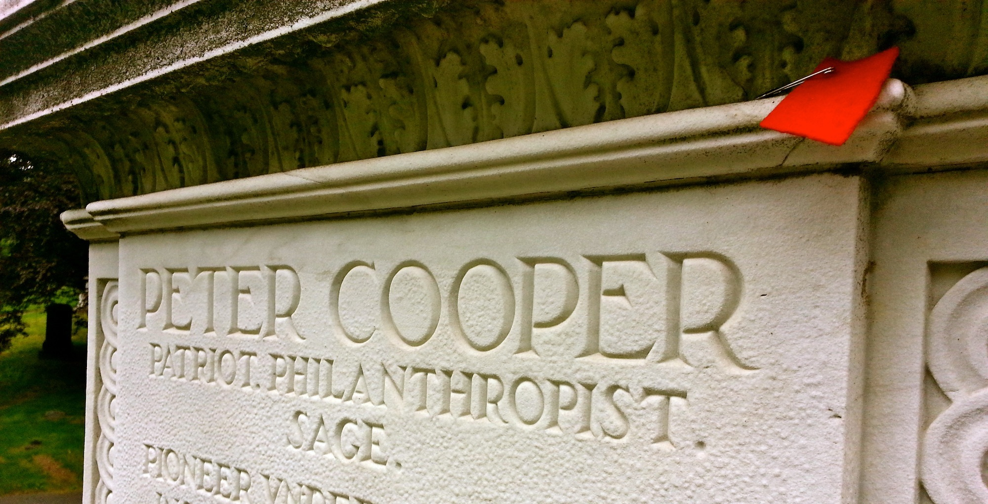 The grave of Peter Cooper, founder of Cooper Union College, with a red solidarity square placed upon it. Photo: Justin Wedes